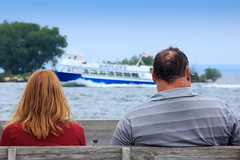 Watching Boats Go By (Robert F. Carter Travels) Tags: bench boat boats sheplers stignace tourist tourists people greatlakes lakehuron ferry ferryboats