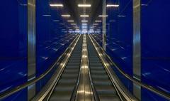 I/I\I (Blende1.8) Tags: escalator escalators rolltreppe rolltreppen blau blue underground metro station subway ubahn aufgang exit symmetry symmetrie architecture architektur modern modernearchitektur urban city düsseldorf wideangle sony emount ilce7rm2 sel1224g 12mm a7rm2 a7rii alpha carstenheyer line lines