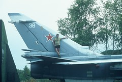 8a. Sasha climbs on to a MIG fighter in a closed military airfield, a day south of Kharbarovsk