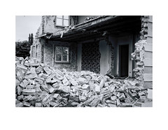 "People & Things I met(twurst) [30/30] by nick.schn - A house gets demolished, Germany 10/25/17 at 09:54 am.   About the series (to which the Photo above belongs)  First I would like to mention: Fuck you reality! Fuck you so much and fuck your unbearable pigheadedness!  At least for me a somewhat uncomfortable truth: almost all my photos show trivialities. Nothing of political or general social significance, no dramas, no stories, nothing about love or hatred and hardly anything about people or their relationships. I have not even dealt with the beauty of nature carefully and that would be an obvious topic for a contact-avoiding hobby-photographer.   Most of the photos were shot during walks around my neighborhood. I have arranged them, so that the sequence may cause associations.  Fuck you reality, fuck you so much, I want to be cheated!   About the post-processing   For editing I've used the Lightromm plug-in ""Silver Efex Pro 2"". More precisely: Preset ""Film Noir 3"" as a basis (nr. 32), but with some modifications. Apart from other small corrections (eg in contrast or exposure) I removed the artificial grain and the frame of the preset and I added a blue toning for all the photos of the series. And: For almost all photos I used a green or blue color filter."