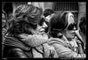 Atendiendo la explicación (Montse Estaca) Tags: italia italy friuliveneziagiulia trieste eoijesúsmaestro retrato portrait ritratto sisters sorelle hermanas women mujeres donne bufanda coat abrigo gafasdesol occhialidasole sunglasses scarf sciarpa streetphotography bw bn bianco blanco black negro nero white cappotto fuji fujixt1