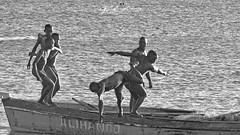 JUMPING_FOR_FREEDOM_OF_THE_SEA_MUZUANE_BEACH_NACALA_MOZAMBIQUE (paulomarquesfotografia) Tags: paulo marques sony hx400v sea mar jump salto pretoebranco bw blackandwhite black and white pessoas boat barco praia beach ceu sky pescador fisherman