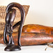 Africian Hand Carved Wooden Statue with Basket and Calabash in background