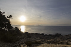 winter sun above island losinj (cyberjani) Tags: adriatic sea istria coast beach rocks sunset