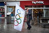 Olympic Hopeful (Silver Machine) Tags: southampton hampshire streetphotography street candid man walking smoking olympicflag flag olympics shops shopping cap fujifilm fujifilmxt10 fujinonxf35mmf2rwr