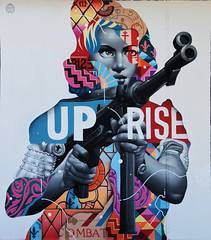 Uprise, a visual history of protest and resistance (HBA_JIJO) Tags: streetart urban graffiti art france artist wall mur painting aerosol peinture portrait murale spray woman gun bombing femme tristaneaton urbain girl resist urbaine arme culture revolte