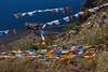 Flagged (winniegotmilk) Tags: lugu lake sichuan china asia flags buddhist colors colorful water