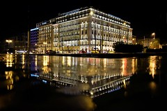 Athens lights and colors (Artemios Karavas) Tags: artemiosphotos athens architecture reflections refection traffic beautiful greece lighttrails night light photography move building city town water rain attica streetphotography urban