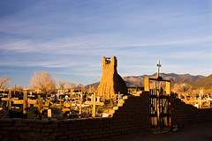 Cemetery and Old Church Tower (colin grubbs) Tags: cemetery church taos pueblo ruins cross travel unesco newmexico sunset mountains desert nativeamerican graves