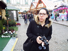 Not while I'm eating... Nina at the Christmas Market in Belfast December 2017 (sean and nina) Tags: nina christmas market belfast city centre public candid street photography woman female girl lady girlfriend fiancee wife happy amiling marries black duffle coat dress legs dm boots doc martens beauty gorgeous stunning amazing cute charm charming serb north northern ireland irish eu europe european aire glasses brunette long dark hair camer people persons outdoor outside model perfect december 2017 eating drinking smiling walking incredible pose posed posing unposed