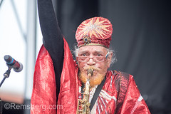 Marshall Allen, band leader for Sun Ra Arkestra, puts his arm in the air as he belts out on the saxophone on stage at National Folk Life Festival, Greensboro, North Carolina. (Remsberg Photos) Tags: arts culture event festival folk greensboro music national ncta northcarolina stage traditional sunra sunraarkestra bigbandfreejazz bigband jazz freejazz improv marshallallen saxophone sax woodwindinstrument brass experimentalmusic cosmic egyptiangodofthesun saturn spaceage concert performance entertainment show act musician band performer playing sparkly costumes flashy glittery jazzy africanamerican preformance live livemusic usa