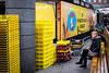 Behind the Crates (dbrugman) Tags: dordrecht netherlands street streetphotography market crates yellow bench break fujifilm xt1 xf35mmf2