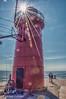 The Lighthouse at South Haven (Michael Guttman) Tags: lighthouse southhaven michigan lakemichigan lake pier sunburst sunstar blackriver river water sky sun southhavenlight redlighthouse sliderssunday hss