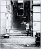 Jan 01, 2018 (pavelkhurlapov) Tags: buildings woman passage stairs shop sign geometry trashcan monochrome streetphotography back alley road kowloon pipe