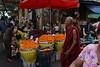 DSC_7945 (Kent MacElwee) Tags: monk buddhistmonk yangon rangoon myanmar burma southeastasia asia market people produce fruit