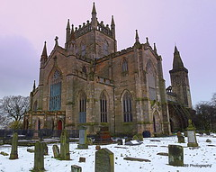 Dunfermline Abbey (Rollingstone1) Tags: dunfermlineabbey dunfermline scotland church graveyard burialplace king queen medieval building stone architecture settlement history historic monarch benedictine gable monastry robertthebruce tomb gravestones winter snow sky tower arch arches windows window spire doorway artwork