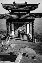 Spiritual sea (Go-tea 郭天) Tags: yantai sea water side shore pavillon ancient hill yantaishi shandongsheng chine cn up down candid traditional tradition history historical historic wodden construction nature element spirituality spiritual rocks women ladies together alone lonely sun sunny day cold winter shadow walk walking out old young street urban city outside outdoor people bw bnw black white blackwhite blackandwhite monochrome naturallight natural light asia asian china chinese shandong canon eos 100d 24mm prime
