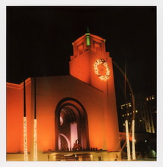 Union Station Christmas (tobysx70) Tags: polaroid originals color 600 instant film slr680 union station christmas alameda street downtown los angeles la california ca fairy lights decorations wreath night nocturnal floodlit lit illuminated clock tower palm tree railway train amtrak traffic red green orange toby hancock photography
