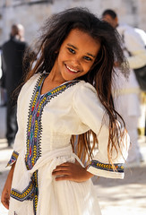 The mini supermodel (ybiberman) Tags: ethiopianchurch streetphotography israel jerusalem candid child girl people portrait posing wedding