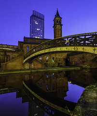 When Old Meets New (SimonMCR) Tags: city cityscape citylights manchester england bluesky bluehour blue canal bridgewatercanal britain bridge water castlefield beetham tower morning chapel church light old new fujixt2 fujifilm fuji1024mm architecture art