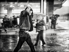 the.downpour.part.IV (grizzleur) Tags: olymplus omd olympusomdem5mkii omdstreetphotography bw mono monochrome blackandwhite street photography candid rain downpour raining stron heavy guy cover jacket stride