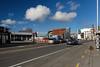 Cotten Wool Clouds (Jocey K) Tags: newzealand nikond750 southisland christchurch architecture buildings rebuild street road bus cars signs clouds sky trees shadows streetart clocktower clock