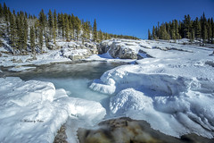 Frozen Falls (Canon Queen Rocks (2,342,500 + views)) Tags: water waterfalls elbowfalls elbowvalley white sky scenery scenic snow winter river ice frozen trees rocks filters momentsbycelinecom rockies alberta colours bluesky blues icicles nature canada rock tree landscapes landscape landschaft