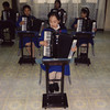 Polaroid of accordion classroom with North Korean students in Mangyongdae children's palace, Pyongan Province, Pyongyang, North Korea (Eric Lafforgue) Tags: 2 accordion asia asian aspirations child children classmates classroom clothing communism concentration creativity dictatorship dprk education elementaryschool enjoyment groupofpeople indoors knowledge learning music musicinstrument musicalinstrument musician northkorea northkorean occupation perform performance playing polaroid pyongyang school skill squarepicture studying teaching uniform pyonganprovince 北朝鮮 북한 朝鮮民主主義人民共和国 조선 coreadelnorte coréedunord coréiadonorte coreiadonorte 조선민주주의인민공화국 เกาหลีเหนือ קוריאההצפונית koreapółnocna koreautara kuzeykore nordkorea північнакорея севернакореја севернакорея severníkorea βόρειακορέα