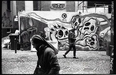 (Others) (Robbie McIntosh) Tags: leicam2 leica m2 rangefinder streetphotography 35mm film pellicola analog analogue negative leicam summicron analogico leicasummicron35mmf20iv blackandwhite bw biancoenero bn monochrome argentique summicron35mmf20iv autaut dyi selfdeveloped filmisnotdead leicasummicron35mmf2iv strangers candid guessexposure sunny16 nometering kodaktrix kodak trix pulcinella d76 skulls nun sister man woman graffiti streetart