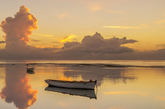 Reflection Lagoon Mauritius (Malaquin Eric ........ thanks for your visits & co) Tags: twilight lagoon reflection ericmalaquin endoftheday 35mm pentax clouds coucherdesoleil colors cumulonimbus crepuscule water ocean boat fishingboat fishingboats lagon light canoe atmosphere aftersunset mauritius ilemaurice indianocean bankofclouds barque maurice mer