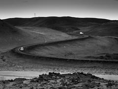 Duel (objet introuvable) Tags: blackandwhite bw noiretblanc nb nature iceland islande road route monochrome cars van camion montagne truck