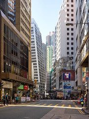 Dec 27, 2017 (pavelkhurlapov) Tags: architecture buildings geometry colors sunlight road crossing lamppost cityscape people skyscrapers sky city sheungwan leaning