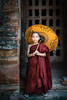 The Yellow Umbrella v2 (Trent's Pics) Tags: bagan boy buddha buddhist child lifestyle monastery monk myanmar parasol people portrait ruins spiritual temple umbrella