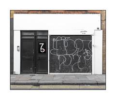 Shutter (Unknown), East London, England. (Joseph O'Malley64) Tags: unknow graffiti urbanart publicart freeart streetart eastlondon eastend london england uk britain british greatbritain defacement defaced throwie tags shutter rollershutter shop shopfront business businesspremises doors glassdoors reinforcedglass doorways entrances exits intercom keypadentrysystem cctv cctvcamera render brickwork bricksmortar cement pointing wiring electricalwiring stopcocks accesscover pavement granitekerbing tarmac doubleyellowlines nosparkingatanytime parkingrestrictions sign signage urban urbanlandscape aerosol cans spray paint fujix x100t accuracyprecision