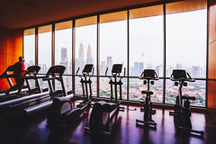 Fitness room with cityscape view in background, Kuala Lumpur Malaysia (Patrick Foto ;)) Tags: activity area background business center city cityscape club concept empty equipment exercise fitness gym health healthy hotel indoor interior kualalumpur lifestyle luxury machine malaysia modern nobody people place recreation room sport steel strength tourism training travel treadmill vacation view weights wellness white window windows workout wilayahpersekutuankualalumpur my