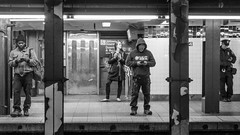 4 (John St John Photography) Tags: subway streetphotography 34thstreet subwaystation pennstation mta newyorkcity newyork four people peopleofnewyork mobile cell smartphone commuters waiting trains ctrain bw blackandwhite blackwhite blackwhitephotos candidphotography johnstjohn