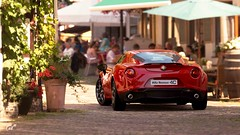Alfa Romeo 4C (at1503) Tags: blur germany alfaromeo 4c alfaromeo4c red plants cafe urban buildings stone light sunny granturismo granturismosport digitalphotography digitalmotorsport ps4 game racing
