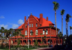 Red Brick Beauty (PelicanPete) Tags: keywest florida southflorida usa unitedstates arches floridakeys islandchain keywestmuseum red brick flag palm old historic architecture tree building tower historicbuilding large customhouse museum oldpostoffice contrast colorful redandblue redbrickbeauty sunlit multiplechimneys flags romanesque built1889