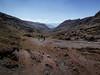 Mountain walk in Lares, Peru (berreverresen) Tags: peru walking dark sky mountains cold altitude orange people clouds lares