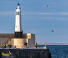 The Outer Harbour Lighthouse at Peel, Isle of Man. (staneastwood) Tags: stanleyeastwood staneastwood coast water shore harbour shoreline bay cloud sky isleofman im people fisherman lighthouse sea