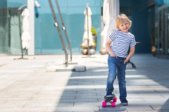 Adorable kid outdoors. Cute pretty cheerful child holding skateboard and smiling at camera. Casual boy on summer time skating on a skateboard. (elenachukhil) Tags: boy child kid skateboard skate outdoors emotional pretty little cute son havingfun outside strippedshirt summer spring happy happiness childhood adorable very blond longhair human people spendingtime leisure joy male jeans hobby expression fun youth sport roller smile enjoy ride person white skater cheerful caucasian active