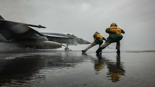 An F/A-18E Super Hornet launches from USS Theodore Roosevelt.