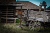 Derelict wagon & dinner bell - Old Train Town - Cody, Wy (DT's Photo Site - Anderson S.C.) Tags: canon 40d tamron 1750mmefs lens codywy wyoming wagon country western road weeds dinnerbell building shed barn outside wildflower grass wheel hub hauling abandoned vanishing vintage antique storied west plains farm scenic landscape america usa frontier summer cowboys