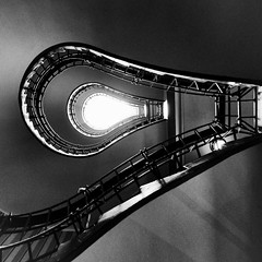 Light Bulb Staircase (Dalliance with Light (Andy Farmer)) Tags: stairway prague abstract architecture cubist houseoftheblackmadonna lightbulb bw czechrepublic cubistmuseum