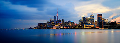 Toronto in Blue (Brady Baker) Tags: toronto canada ontario lake harbor waterfront skyline cityscape urban water reflection lights cloud blue dusk architecture outdoor cntower