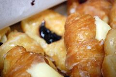 Various Filled Croissants. (dccradio) Tags: lumberton nc northcarolina robesoncounty cakespastries cakesandpastries doughnut donut croissant filledcroissant jelly jam frosting creamcheese whitefrosting chocolatefrosting raspberry blueberry glaze glazed treat sweet dessert breakfast food eat snack junkfood nikon d40 dslr