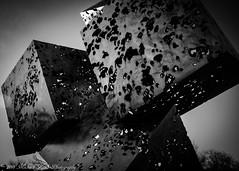 IMG_8488-2 (mayor_79) Tags: shapes cubes black white contrast shadow light lines angles grain film holes boxes box sculpture art texture canon rebel t5 1200d gray batavia bridge square metal illinois il artistic statue metallic shiny sky