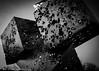 IMG_8488-2 (mayor_79) Tags: shapes cubes black white contrast shadow light lines angles grain film holes boxes box sculpture art texture canon rebel t5 1200d gray batavia bridge square metal illinois il artistic statue metallic shiny