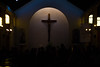 Oración al atardecer (Gustavo AMJ.) Tags: cross church temple catholic people afternoon dark darkness religion pray faith light window shrine city shadow holidays travel urban evening photo photography yungay chile nikon nikond3100