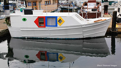 Colourful Small House Boat, Inner Harbour, Victoria, British Columbia, Canada (Black Diamond Images) Tags: colourful smallhouseboat houseboat innerharbour victoriaharbour victoria britishcolumbia canada boat reflection reflections whiteboat